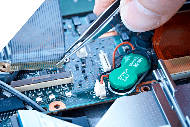 Man connecting a ribbon cable to a PCB